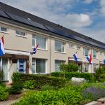 Vlaggen uit bij oplevering opgeknapte woningen Lageweg